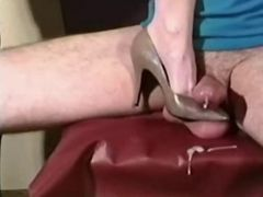 You can watch a few scenes in which women's feet in shoes crush balls. They ruthlessly squeezing cum out of balls which is derived from the urethra directly to women's feet and shoes
