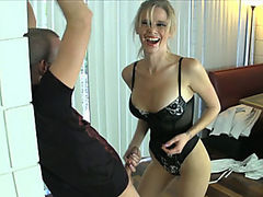 She teases Billy with her body while she talks about how she wants to cut his balls off. Then she starts with more torment. She gets on her back and plays with his cock and balls with her high heels.